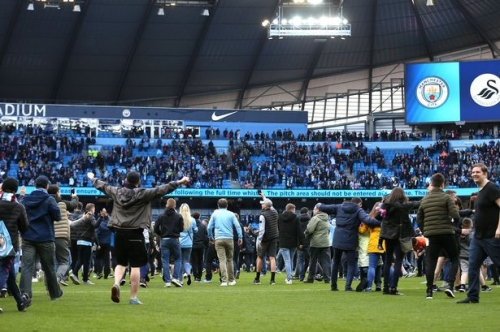 Best pictures of Man City fans celebrating the title on the Etihad pitch