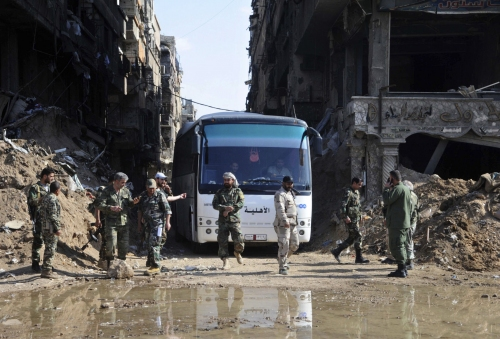 The Latest: Syrian rebels surrender north of Homs