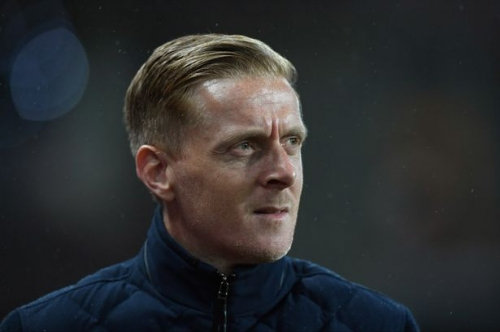 Former Swansea City boss Garry Monk pays for Birmingham City fan to have his face tattooed on his bum