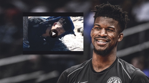 Timberwolves video: Jimmy Butler caught hugging tree while hiking