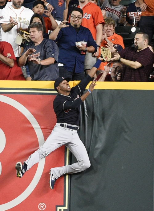 Cleveland Indians RF Greg Allen robs Houston Astros 3B Alex Bregman of extra bases with leaping catch