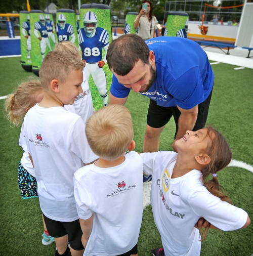 Andrew Luck can lug around a kid with his right arm, so that's a good sign, right?