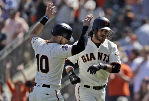 Crawford continues prolific month at the plate, leads Giants to win over Rockies