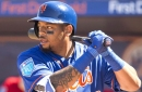 Dominic Smith playing the outfield for Mets' Triple-A team