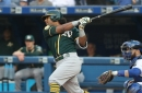 Khris Davis leaves game early after appearing to pull muscle