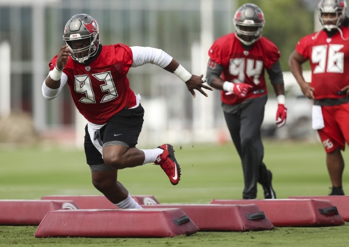 Gerald McCoy appreciates help on D-line, but knows it will take more than names on paper