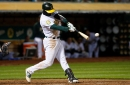 A's win streak snapped by Mariners in extra innings