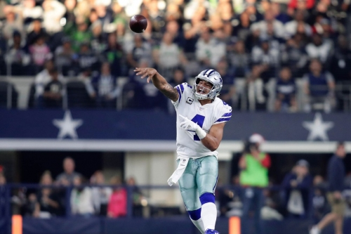 Dak Prescott looks to be done with the glove on his non-throwing hand