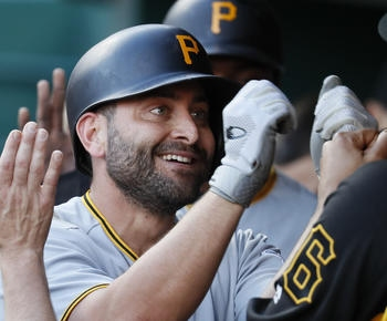 Harrison's triple in 12th sends Pirates over Reds 5-4