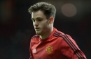 Manchester United defender Joe Riley leaves the club