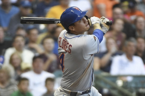 Wilmer Flores leaves game with lower back soreness