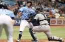 Mariners win on play at the plate, beat Rays 5-4