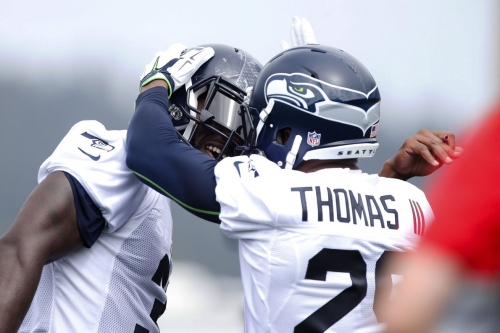 How the Marshawn Lynch, Kam Chancellor holdouts went