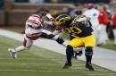 Michigan's Drake Johnson is dragged down with a face mask penalty on Rutgers' Kiy Hester, setting up a Michigan touchdown late in the second quarter on Saturday, Nov 7, 2015 in Ann Arbor, Mich.
