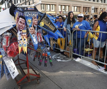 The Latest: Warriors throw T-shirts to fans as parade begins