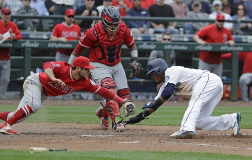 Angels lose two more players in wild loss to Mariners