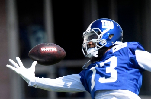 Odell Beckham Jr. tells reporters he will attend NY Giants training camp, won't hold out