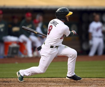 Jed Lowrie's three-run double rallies A's past Padres 6-2