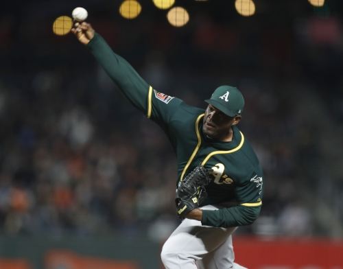 A's place Casilla on waivers, recall top-hitting prospect