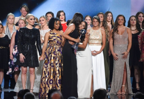 Led by Aly Raisman, more than 140 Larry Nassar victims accept Arthur Ashe Courage Award at ESPYS