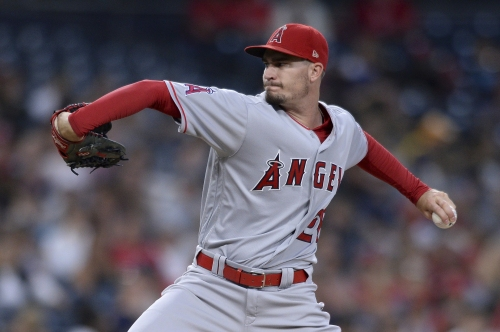 Andrew Heaney's strong outing and a late offensive outburst lead Angels to 10-inning victory over Padres
