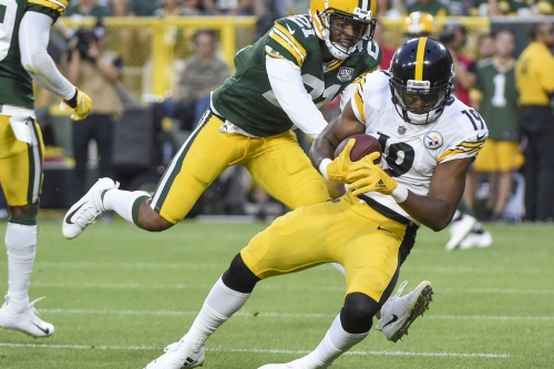 Members of the Steelers and Mike Tomlin react to the team's performance vs. Green Bay