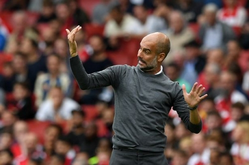 Man City manager Pep Guardiola reacts to Kevin De Bruyne injury