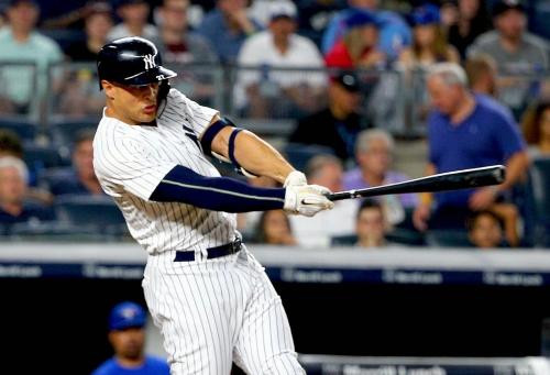 New York Yankees win rain-shortened game over Blue Jays to pick up Lance Lynn