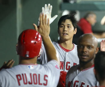 Pujols has season-high 4 RBIs, Angels beat Rangers 11-7