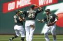 Athletics beat Astros 7-1 to move into tie for AL West lead