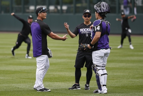 Interpreter, assistant, best friend: Meet Eugene Koo, the critical right-hand man for Rockies' reliever Seunghwan Oh