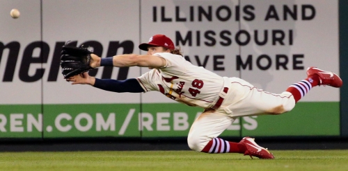 Nobody does it Bader: Cardinals center fielder approaching the game headfirst