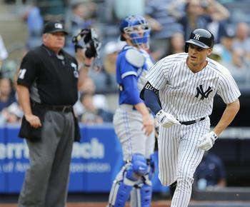 Happ gets slam help from Bird, Yankees beat Blue Jays 10-2