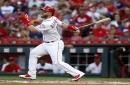 Cincinnati Reds' Tucker Barnhart commits error at first base when ball breaks his glove