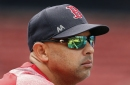 Alex Cora wears LSU jersey during Red Sox batting practice after losing bet to Astros' Alex Bregman