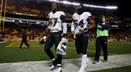 Ravens LB C.J. Mosley carted off field with knee injury