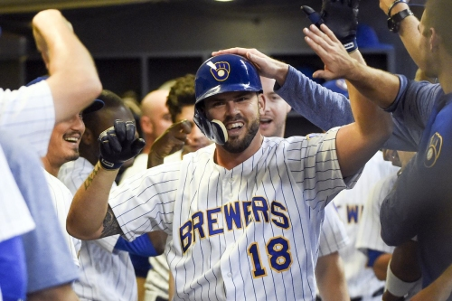 Brewers beat Pirates 7-4, keep pace with Cubs