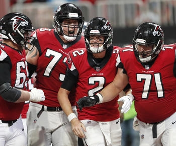 Matt Ryan shines with arm and legs, Falcons beat Panthers 31-24