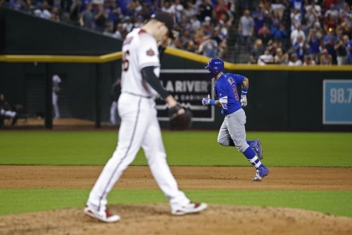Javier Baez hands Diamondbacks another loss as Cubs fans take over Chase Field