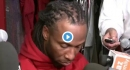 Larry Fitzgerald stops press interview surrounded by reporters to watch Tiger Woods drain eagle putt at Tour Championship