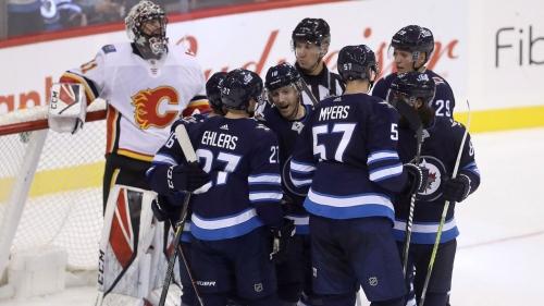 Dustin Byfuglien scores in overtime, Jets beat Flames in pre-season