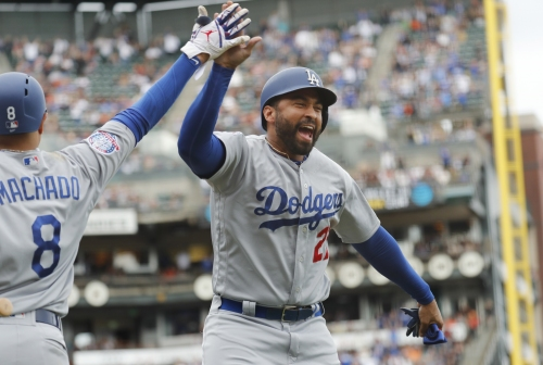 Dodgers clinch playoff berth with win over Giants