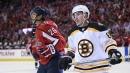 Bruins' Brad Marchand jumps Capitals' Lars Eller down 7-0