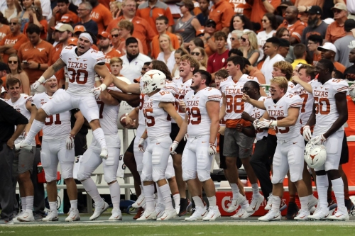 Look: Texas guard Patrick Vahe plants Texas flag in OU endzone after Red River Showdown win
