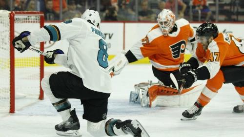 Sharks spoil Flyers' home opener in romp