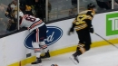 Glass pops out after Bruins' Kuraly hits Oilers' Benning