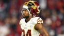 Josh Norman wore headphones during a halftime speech, resulting in him being benched