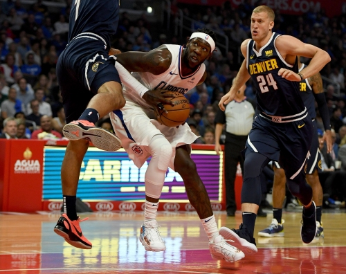Clippers rally for late lead before losing to Nuggets in season opener