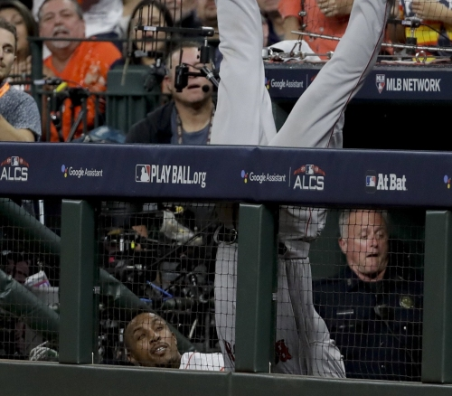 Boston Red Sox's Steve Pearce goes headfirst into Astros dugout trying to catch foul ball (video)