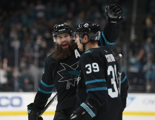 Couture's hat trick, power play charge Sharks win over Sabres